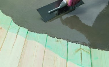 Fibre reinforced smoothing compound applied to wooden floorboards