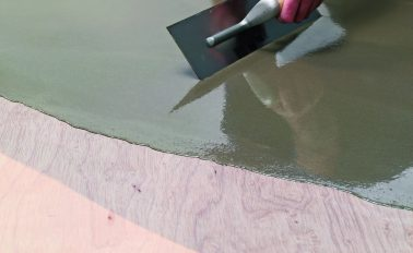 Fibre reinforced smoothing compound applied to plywood flooring