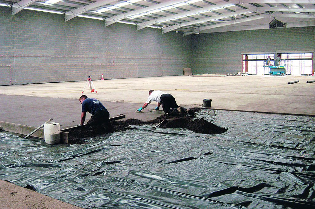 Applying screed on a warehouse floor