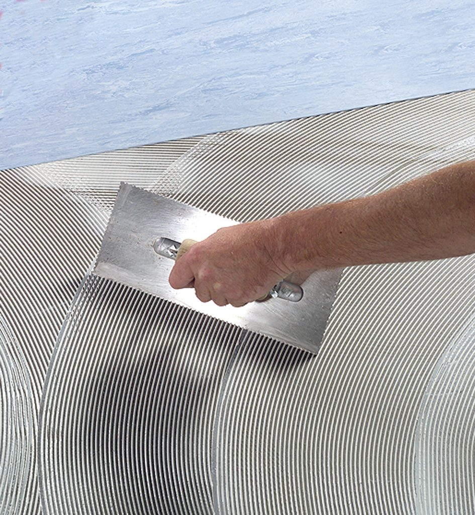 Application of lino adhesive