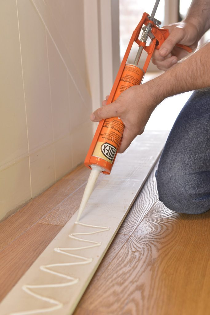Skirting board adhesive