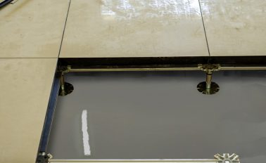 ARDEX WPM 200 waterproofing under raised access flooring.