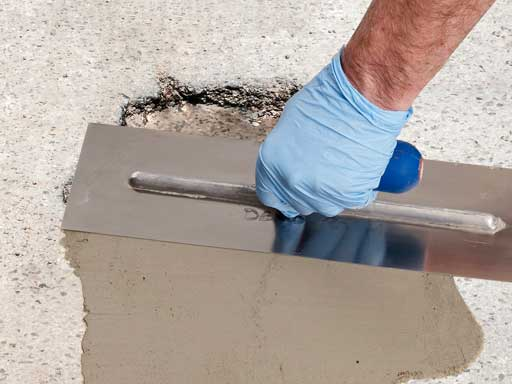 Repair any holes or cracks in the concrete